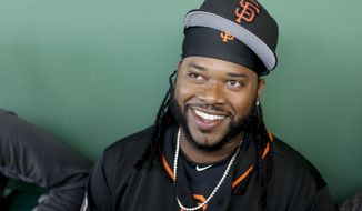 San Francisco Giants starting pitcher Johnny Cueto talks to the media before a spring training baseball game in Scottsdale, Ariz., Saturday, March 4, 2017. (AP Photo/Chris Carlson)