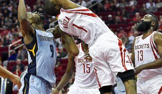 Houston Rockets forward Trevor Ariza (1) grabs a rebound over Memphis Grizzlies guard Tony Allen (9) in the first half of an NBA basketball game, Saturday, March 4, 2017, in Houston. (AP Photo/Eric Christian Smith)