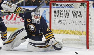 Buffalo Sabres goalie Robin Lehner reaches for the puck during the second period of the team's NHL hockey game against the Tampa Bay Lightning, Saturday, March. 4, 2017, in Buffalo, N.Y. (AP Photo/Jeffrey T. Barnes)
