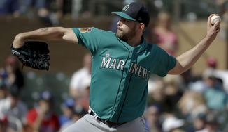 Seattle Mariners starting pitcher James Paxton trows against the Colorado Rockies during fourth inning at a spring baseball game in Scottsdale, Ariz., Saturday, March 4, 2017. (AP Photo/Chris Carlson)