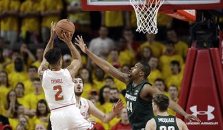 Maryland guard Melo Trimble (2) shoots over Michigan State forward Nick Ward and guard Matt McQuaid (20) in the first half of an NCAA college basketball game, Saturday, March 4, 2017, in College Park, Md. (AP Photo/Patrick Semansky)