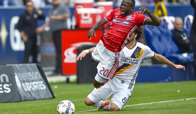 Los Angeles Galaxy midfielder Joao Pedro (8), of Portugal, trips FC Dallas forward Roland Lamah (20) while attempting the steal during an MLS soccer match, Saturday, March 4, 2017, in Carson, Calif. (AP Photo/Gus Ruelas)