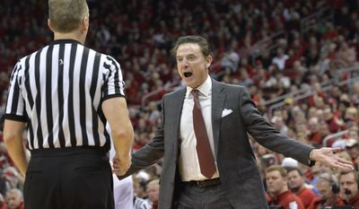 Louisville's head coach Rick Pitino argues a call with a game official during the first half of an NCAA college basketball game against Notre Dame, Saturday, March 4, 2017, in Louisville, Ky. (AP Photo/Timothy D. Easley)