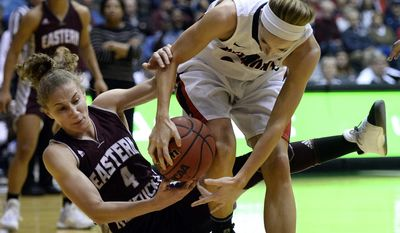 Eastern Kentucky guard Alexus Cooper (4) and Belmont forward Jenny Roy, right, fight for the ball during the first half of an NCAA college basketball game in the championship of the Ohio Valley Conference tournament Saturday, March 4, 2017, in Nashville, Tenn. (AP Photo/Mark Zaleski)