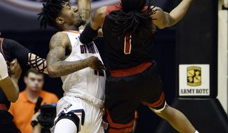 Jacksonville State guard Greg Tucker (1) scores against Tennessee-Martin Fatodd Lewis, left, during the first half of an NCAA college basketball game in the championship of the Ohio Valley Conference basketball tournament Saturday, March 4, 2017, in Nashville, Tenn. (AP Photo/Mark Zaleski)