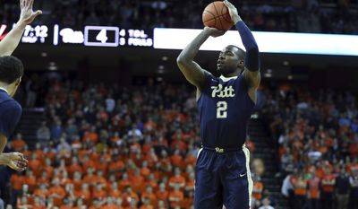 Pittsburgh forward Michael Young (2) shoots during the first half of an NCAA college basketball game against Virginia. Saturday, March 4, 2017, in Charlottesville, Va. (AP Photo/Ryan M. Kelly)