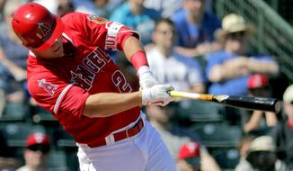 Los Angeles Angels' Mike Trout follows through on a double during the second inning of a spring training baseball game against the Texas Rangers, Wednesday, March 1, 2017, in Tempe, Ariz. (AP Photo/Matt York)