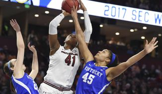 South Carolina center Alaina Coates (41) shoots as Kentucky's Makenzie Cann (22) and Alyssa Rice (45) defend in the first half of an NCAA college basketball game during the Southeastern Conference tournament on Saturday, March 4, 2017, in Greenville, S.C. (AP Photo/Rainier Ehrhardt)