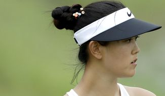 Michelle Wie of the United States looks at her ball on the 8th hole during the HSBC Women's Champions golf tournament held at Sentosa Golf Club's Tanjong course on Saturday, March 4, 2017, in Singapore. (AP Photo/Wong Maye-E)