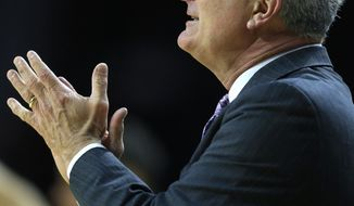 Kansas State head coach Bruce Weber applauds his team during the first half of an NCAA college basketball game against Texas Tech in Manhattan, Kan., Saturday, March 4, 2017. (AP Photo/Orlin Wagner)
