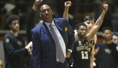 Wake Forest head coach Danny Manning watches from the bench during the first half of an NCAA basketball game against Wake Forest, Saturday, March 4, 2017 in Blacksburg, Va. (Matt Gentry/The Roanoke Times via AP)