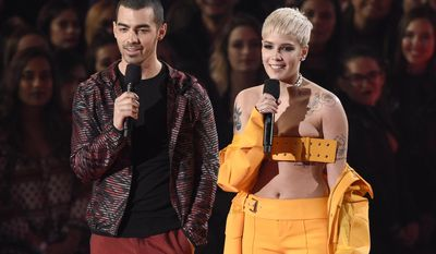 Joe Jonas, left, and Halsey introduce a performance by Big Sean at the iHeartRadio Music Awards at the Forum on Sunday, March 5, 2017, in Inglewood, Calif. (Photo by Chris Pizzello/Invision/AP)