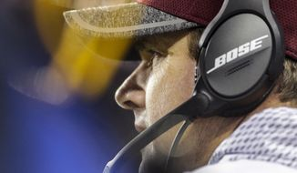 Washington Redskins head coach Jay Gruden watches the action on the field during the second half of an NFL football game against the New York Giants in Landover, Md., Sunday, Jan. 1, 2017. (AP Photo/Mark Tenally)