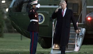 President Donald Trump salutes as he disembarks Marine One upon arrival at the White House in Washington, Sunday, March 5, 2017. (AP Photo/Manuel Balce Ceneta)
