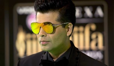 """FILE - In this June 24, 2016, file photo, Bollywood film maker Karan Johar poses for photographers at the International Indian Film Academy (IIFA) Rocks Green Carpet for the 17th Edition of IIFA Weekend and Awards in Madrid, Spain. Leading Bollywood filmmaker Johar says he's become a parent to twins born via surrogate. Johar tweeted Sunday, March 5, 2017 that the decision to have children was """"emotional"""" yet """"well thought out."""" (AP Photo/Samuel de Roman, File)"""