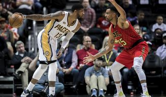 Indiana Pacers forward Paul George (13) controls the ball while defended by Atlanta Hawks forward Thabo Sefolosha (25) during the first quarter of an NBA basketball game, Sunday, March 5, 2017, in Atlanta. (AP Photo/Branden Camp)