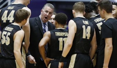 Purdue head coach Matt Painter talks to his team during the first half of an NCAA college basketball game against Northwestern, Sunday, March 5, 2017, in Evanston, Ill. (AP Photo/Nam Y. Huh)