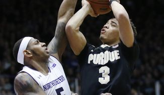 Purdue guard Carsen Edwards, right, shoots against Northwestern center Dererk Pardon during the first half of an NCAA college basketball game, Sunday, March 5, 2017, in Evanston, Ill. (AP Photo/Nam Y. Huh)