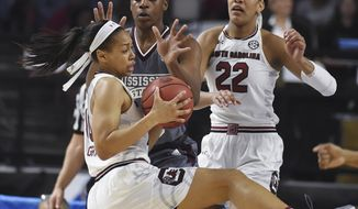 South Carolina guard Allisha Gray (10) come down with a rebound as Mississippi State center Teaira McCowan (15) defends and South Carolina forward A'ja Wilson (22) looks on in the first half of an NCAA college basketball game during the Southeastern Conference tournament on Sunday, March 5, 2017, in Greenville, S.C. (AP Photo/Rainier Ehrhardt)