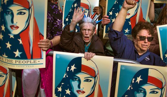 Protesters rallied in New York City last month against President Trump's initial executive order banning travel from seven Muslim-majority nations. More protests are on the way against the revised version. (Associated Press)