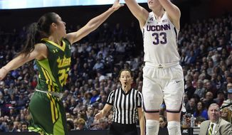 Connecticut's Katie Lou Samuelson shoots over South Florida's Laia Flores, left, during the first half of an NCAA college basketball game in the American Athletic Conference tournament finals at Mohegan Sun Arena, Monday, March 6, 2017, in Uncasville, Conn. (AP Photo/Jessica Hill)