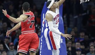 Detroit Pistons forward Tobias Harris (34) dunks on Chicago Bulls guard Michael Carter-Williams (7) during the first half of an NBA basketball game, Monday, March 6, 2017, in Auburn Hills, Mich. (AP Photo/Carlos Osorio)