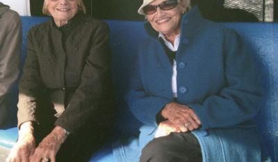 In this September 2015 photo provided by Susan Williams, Martha Williams, left, of East Providence, R.I., sits with her twin sister Jean Haley, of Barrington, R.I., on a ferry en route to the Massachusetts island of Nantucket. The 97-year-old twin sisters died Saturday, March 4, 2017, after they fell outside Jean's home in Barrington and were stranded there during one of the coldest nights of the winter. A neighbor found the twin sisters the next morning. (Susan Williams via AP)
