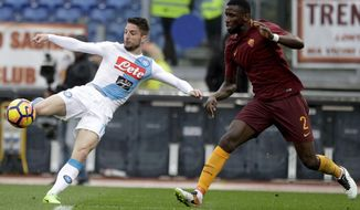 Napoli's Dries Mertens, left, kicks the ball past Roma's Antonio Rudiger during a Serie A soccer match between Roma and Napoli, at the Rome Olympic stadium, Saturday, March 4, 2017. (AP Photo/Gregorio Borgia)