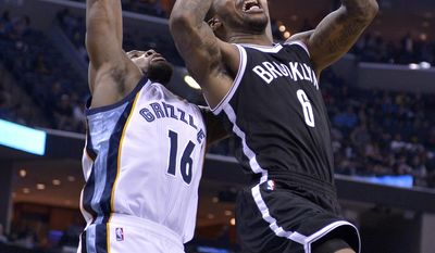 Brooklyn Nets guard Sean Kilpatrick (6) shoots against Memphis Grizzlies guard Toney Douglas (16) in the second half of an NBA basketball game Monday, March 6, 2017, in Memphis, Tenn. (AP Photo/Brandon Dill)