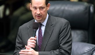 FILE-  In this March 11, 2016 file photo, Sen. President Joe Negron, R-Stuart, speaks during the legislative session in Tallahassee, Fla., Negron and House Speaker Richard Corcoran are Republican lawyers. But the similarities start to drift from there. Negron calls himself boring and he's more the quiet, deliberative type. Corcoran likes listening to music at top volume and his approach to leadership reflects that. (AP Photo/Steve Cannon, File)