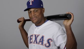 FILE - This is a 2017 file photo showing Adrian Beltre of the Texas Rangers baseball team. Beltre says he will play for the Dominican Republic in the first round of the World Baseball Classic. The five-time Gold Glove winner said Monday, March 6, 2017, in the Rangers' spring training clubhouse that he feels better after playing some exhibition games. The 37-year-old Beltre missed the first week of games for Texas because of a strained left calf, an injury he suffered when working out at home before reporting to camp.(AP Photo/Charlie Riedel, File)