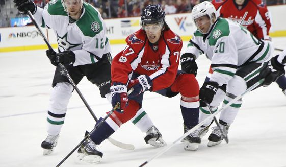 Washington Capitals right wing T.J. Oshie (77) is sandwiched by Dallas Stars center Radek Faksa (12) and teammate Cody Eakin (20) during the second period of an NHL hockey game in Washington, Monday, March 6, 2017. (AP Photo/Manuel Balce Ceneta)