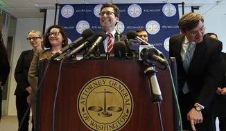 Washington State Attorney General Bob Ferguson smiles during a news conference about President Trump's new executive order Monday, March 6, 2017, in Seattle. Trump signed an executive order Monday ordering new travel restrictions for residents of six Muslim-majority countries as well as a temporary ban on refugees from around the world, retooling a directive issued five weeks ago that stoked chaos at airports and drew international condemnation and a rebuke in the federal courts. The new ban, which takes effect March 16, halts travel for 90 days for residents of Iran, Libya, Somalia, Sudan, Syria and Yemen. (AP Photo/Elaine Thompson)