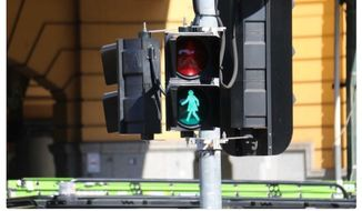 "Australia is experimenting with female traffic signals to combat ""unconscious bias."" (Twitter, ABC News Melbourne)"