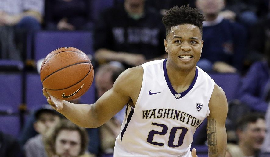 In this Feb. 18, 2017, photo, Washington's Markelle Fultz brings the ball upcourt against Arizona during an NCAA college basketball game in Seattle. Fultz was selected to the AP All-Pac-12 Conference first team, Tuesday, March 7, 2017. (AP Photo/Elaine Thompson, File) **FILE**