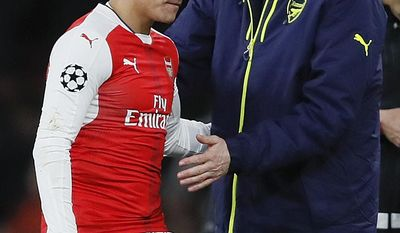 Arsenal's Alexis Sanchez, left hugs with Arsenal manager Arsene Wenger during the Champions League round of 16 second leg soccer match between Arsenal and Bayern Munich at the Emirates Stadimum in London, Tuesday, March 7, 2017. (AP Photo/Kirsty Wigglesworth)