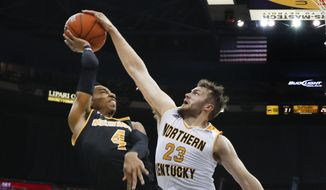 Northern Kentucky forward Carson Williams (23) blocks a Milwaukee guard Jeremy Johnson (4) shot in the first half of the Horizon League NCAA college basketball tournament championship game in Detroit, Tuesday, March 7, 2017. (AP Photo/Paul Sancya)