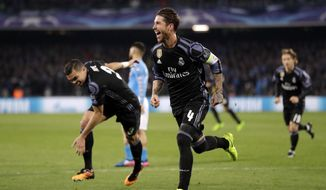 Real Madrid's Sergio Ramos celebrates after scoring his side's second goal during the Champions League round of 16, second leg, soccer match between Napoli and Real Madrid at the San Paolo stadium in Naples, Italy, Tuesday March 7, 2017. (AP Photo/Andrew Medichini)