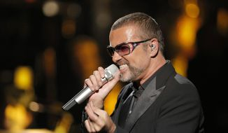 British singer George Michael sings in concert to raise money for AIDS charity Sidaction, in Paris, France, in this Sept. 9, 2012, file photo. A British coroner said Tuesday, March 7, 2017, that Michael died of natural causes as the result of heart disease and a fatty liver. (AP Photo/Francois Mori, File)