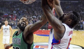 Los Angeles Clippers center DeAndre Jordan, right, dunks as Boston Celtics forward Amir Johnson defends during the first half of an NBA basketball game, Monday, March 6, 2017, in Los Angeles. (AP Photo/Mark J. Terrill)