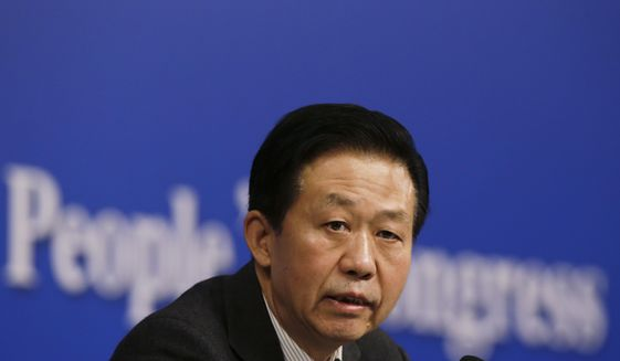 Chinese Finance Minister Xiao Jie speaks during a press conference on the sideline of the National People's Congress at the media center in Beijing, Tuesday, March 7, 2017.   China's finance minister is rejecting accusations that the country is keeping its defense budget under wraps.  Xiao's remarks came after China released its national budget without the usual figure for defense spending. (AP Photo/Andy Wong)