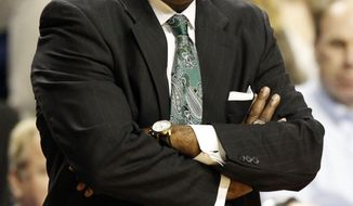 FILE - In this Nov. 25, 2013, file photo, Cleveland State head coach Gary Waters watches his team during the first half of an NCAA college basketball game against Kentucky in Lexington, Ky. Waters, the winningest coach in school history, announced he is stepping down on Tuesday, March 7, 2017,  just days after the Vikings lost in the first round of the Horizon League Tournament to finish 9-22. (AP Photo/James Crisp, File)