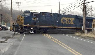 In this photo provided by Joni Dunning Armstrong, the lead locomotive of a CSX freight train blocks a road in Newburgh, N.Y., after going off its rails, Tuesday, March 7, 2017. A CSX spokesperson said the train was carrying sulfuric acid and sodium hydroxide, as well as cardboard, corn oil and glass products when it derailed about 3:30 p.m. CSX says that there are no reports of leaks at this time. (Joni Dunning Armstrong via AP)