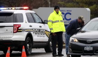 Police officers investigate a bomb threat outside the Louis S. Wolk Jewish Community Center of Greater Rochester in Brighton, N.Y on Tuesday, March 7, 2017.  Brighton Police Chief Mark Henderson said his department will work with the FBI to see if the threat was similar to those received at other JCC facilities across the U.S.   (Tina Macintyre-Yee/Democrat & Chronicle via AP)