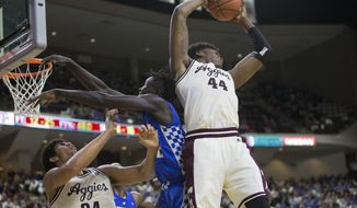 Texas A&M forward Robert Williams (44) grabs a rebound away from Kentucky forward Wenyen Gabriel (32) during the second half of an NCAA college basketball game, Saturday, March 4, 2017, in College Station, Texas. (AP Photo/Sam Craft)