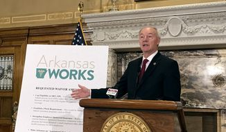 Arkansas Gov. Asa Hutchinson speaks during a news conference on Monday, March 6, 2017, in Little Rock, Ark.  Hutchinson said Monday that he wants to add a work requirement to Arkansas' hybrid Medicaid expansion and to lower its eligibility cap, which would add new restrictions to the program even as the future of the federal health overhaul remains unclear. (AP Photo/Andrew DeMillo)