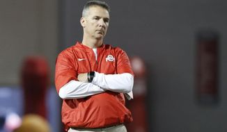 Ohio State head coach Urban Meyer watches his team during spring NCAA college football practice Tuesday, March 7, 2017, in Columbus, Ohio. (AP Photo/Jay LaPrete)