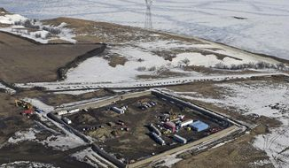 FILE - In this Feb. 13, 2017, aerial file photo shows the site where the final phase of the Dakota Access Pipeline will take place with boring equipment routing the pipeline underground and across Lake Oahe to connect with the existing pipeline in Emmons County near Cannon Ball, N.D. American Indians from across the country are bringing their frustrations with the Trump administration and its approval of the Dakota Access oil pipeline to the nation's capital Tuesday, March 7, 2017, kicking off four days of activities that will culminate in a march on the White House. (Tom Stromme/The Bismarck Tribune via AP, File)