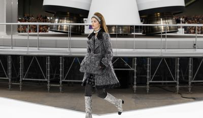 A model wears a creation for Chanel's Fall-Winter 2017/2018 ready-to-wear fashion collection presented Tuesday, March 7, 2017 in Paris. (AP Photo/Francois Mori)