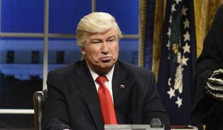 """This Feb. 4, 2017, file photo released by NBC shows Alec Baldwin portraying President Donald Trump in the opening sketch of """"Saturday Night Live,"""" in New York. (Will Heath/NBC via AP, File)"""